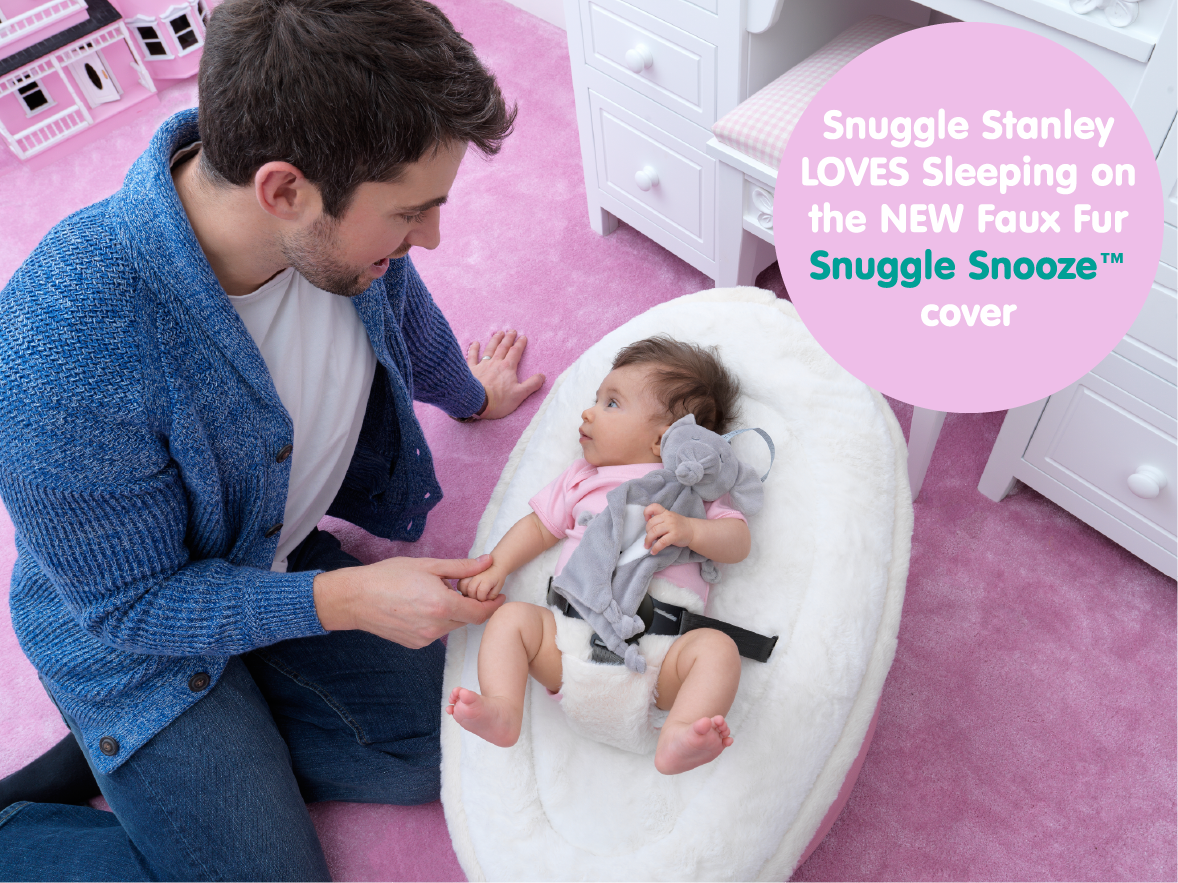 Snuggle Stanley with newborn baby girl and her faux fur baby bean bag harness cover